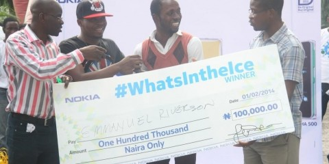 L-R: Retail Marketing Manager, Nokia West Africa, Mr. Olajide Adeyemi; star rapper, Olamide; N100,000 winner of the What's In the Ice competition, Mr. Emmanuel Riverson, and Communications Manager, Nokia West and Central Africa, Mr. Airiafo Oriunuebho during the launch of the new Nokia Asha ICE range held at the E-Centre, Yaba on Saturday February 1