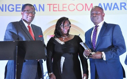 L-R, Former Governor of Ogun State, Otunba Gbenga Daniel with former Commissioner of Ogun State, Dr. Josephine Olatomi Soboyejo presenting the 'Telecom CEO of The Year' Award won by Airtel CEO, Segun Ogunsanya, to the Chief Operations Officer, Airtel, Mr. Tolu Ojo who represented the CEO at the Nigerian Telecom Awards 2014 held on Saturday in Lagos.
